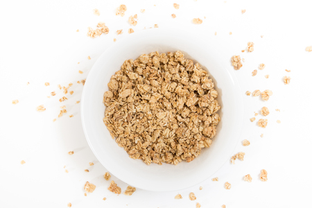 Bowl of granola, on white background. Stock Photo