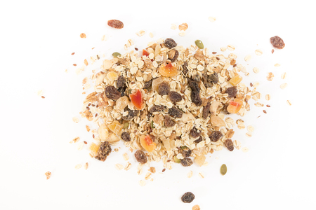 heap: Heap of muesli with dry fruits, on white background.