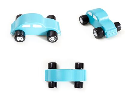A blue toy car front, side and top view, on white background. Stock Photo