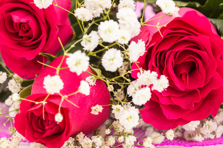 Closeup of red roses bouquet with white flowers Stock Photo