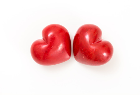 Two red hearts on white background.