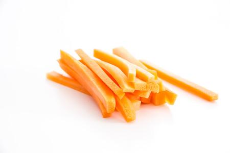 Sliced carrots on white background.
