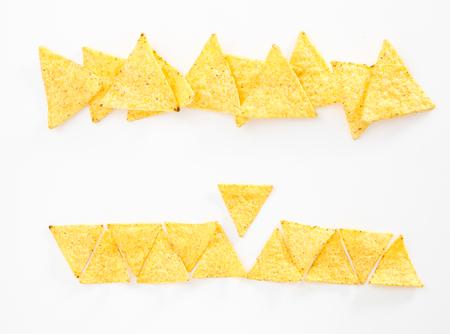 Crispy nacho chips, on white background. Stock Photo
