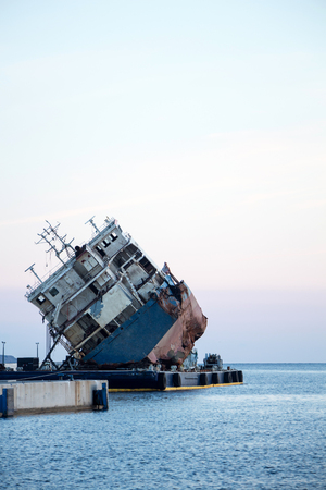 Part of a cargo shipwreck exterior,  background. Stock Photo