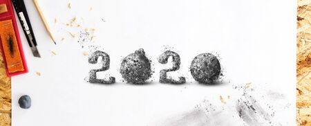 Hand drawn with pencil 2020 number, on white sketching paper, with pencil shavings and smudges. Creative New Year concept.