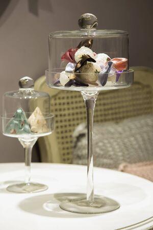 sachets: Set of sachets lies inside a glass coasters. Stock Photo
