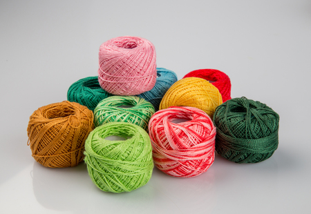 Set of colorful wool yarn balls. Hanks are set out in a pile. Фото со стока
