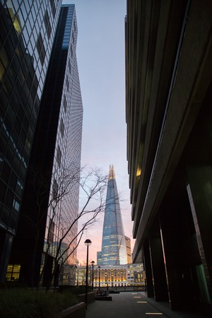 shard: The Shard towering over London, photographed in London, UK. Built in 2012 and standing 306 meters tall, the Shard is currently the tallest building in the European Union and a new London attraction.