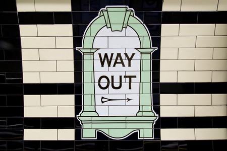 way out: LONDON, UK - April 13, 2015 : Way Out sign, painted on the wall tiles in London Underground, UK