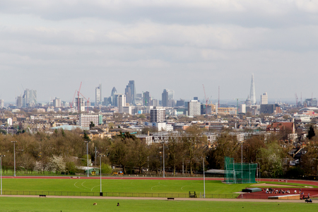 The City of London Cityscape from Hampstead Heath. Buildings include the Shard, Gherkin 30 St Mary Axe, St Pauls, Lloyds Building, Stock Exchange and Walkie Talkie. Stock Photo