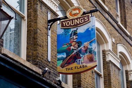 public house: LONDON, UK - April, 13: English pub sign, Public house, known as pub, is focal point of the community