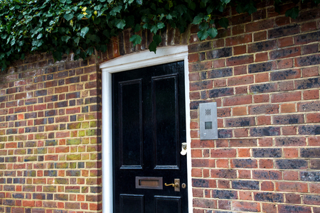 redbrick: Front black Door of an English House, UK