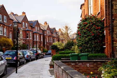 suburban: LONDON, UK - April, 13: Row of red bricks houses in London, english architecture Editorial