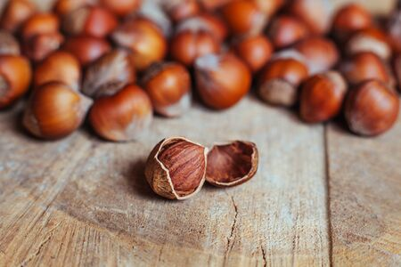Hazelnuts on rustic background