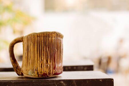 warm colors: bella taza de cerámica con colores cálidos Foto de archivo