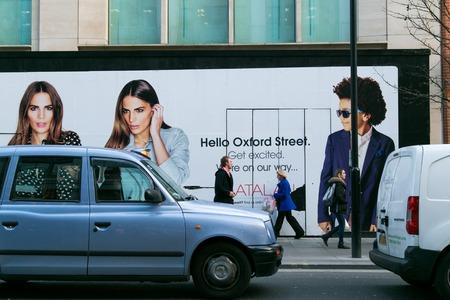 shaftesbury: LONDON, UK - April 08, 2015: Oxford Street. billboard on the hello Editorial