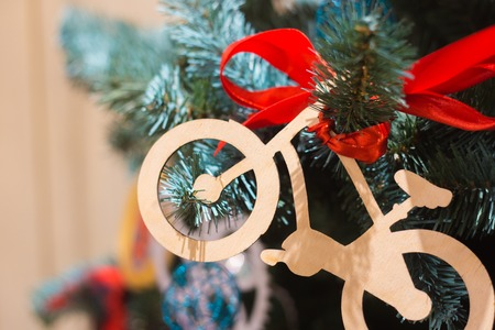 Christmas toy a bicycle on a Christmas tree