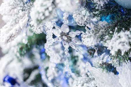 pellucid: Christmas decoration glass snowflake on a Christmas tree