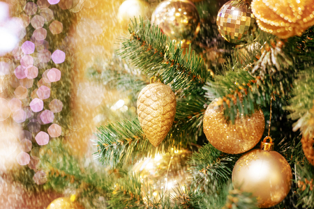 Closeup of Christmas-tree background with golden balls Stock Photo