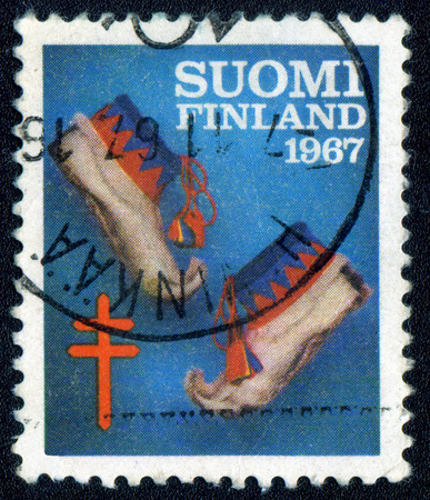 MOSCOW, RUSSIA - 03 June, 2017: A Postage stamp printed by Finland, shows traditional finnish shoes, circa 1967