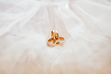 customary: gold wedding rings on a white background Stock Photo