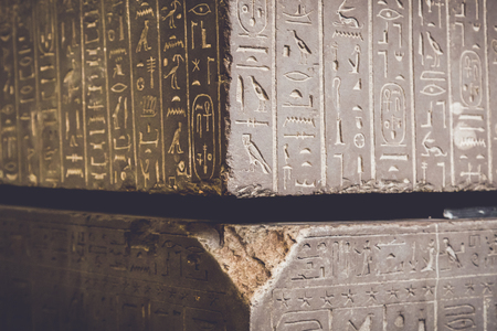 Egypt language symbols written or carved on mummy coffin or Sarcophagus kept at museum