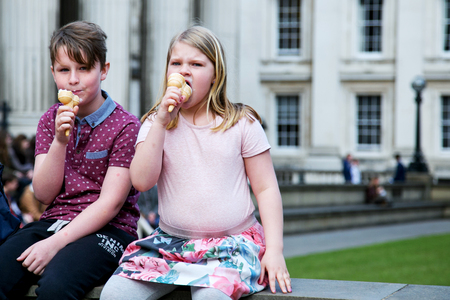 UK, London - April 08, 2015: Children eat ice cream