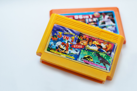Russia, Moscow - 14 July 2017: The original 1996 TV Game cartridge with the Super Mario , Jurassic Park games