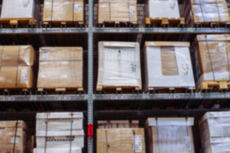 store shelf: interior of warehouse blurring. Rows of shelves with boxes Stock Photo