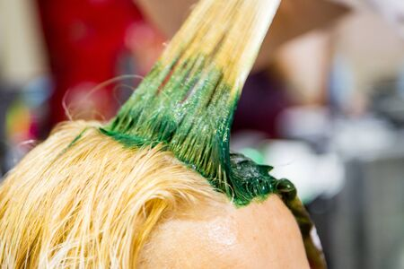 Professional hairdresser dyeing hair. Multicolor Fluorescent staining