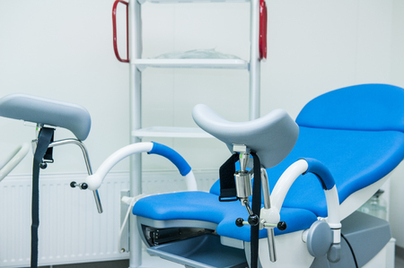 surgical department: Gynecological surgery room with chair and equipment