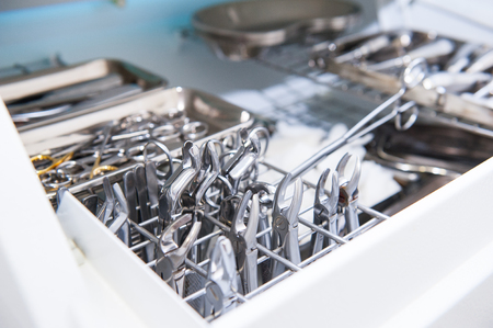 prosthodontics: Close-up of chamber for sterile storage of medical and surgical tools in the dentists office. Surgery. Dentistry. Selective focus