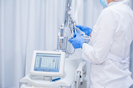 Skin Treatment Laser Equipment. Medical Worker Sets Indices On Screen Of Laser for cosmetic procedures. Close up Beautician Using Beauty Machine In Cosmetology Center, Beauty Salon. Selective focus