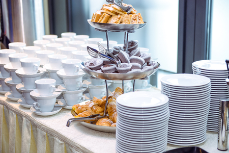 Catering table with dishes and snacks on the business event in the hotel hall. Close up, selective focus. Stock Photo