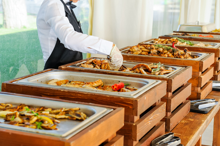 Outdoor Cuisine Culinary Buffet Dinner Catering. Group of people in all you can eat. Dining Food Celebration Party Concept. Service at business meeting, weddings. Selective focus