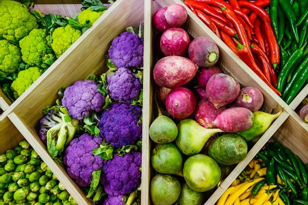 Top view Assortment of fresh vegetables at market counter, vegetable shop, farmer marketplace. Organic, healthy, vegetarian diet food concept. Selective focus Stock Photo