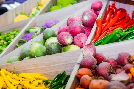 sell: Assortment of fresh vegetables at market counter, vegetable shop, farmer marketplace. Organic, healthy, vegetarian diet food concept. Selective focus