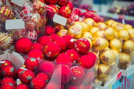 Bunch of red and golden decorations, balls for Christmas and New Year in the supermarket, Selective focus, close up