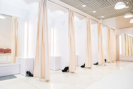 Interior of light dressing room in a female butique. Make Outfit set. Shopping Mall. Shopper. Sales. Shopping Center. Selective focus. Space for text Stockfoto
