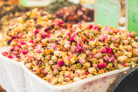 Close up view of tea rose buds on a food market in Tel Aviv, Israel. Selective focus, space for text Stock Photo