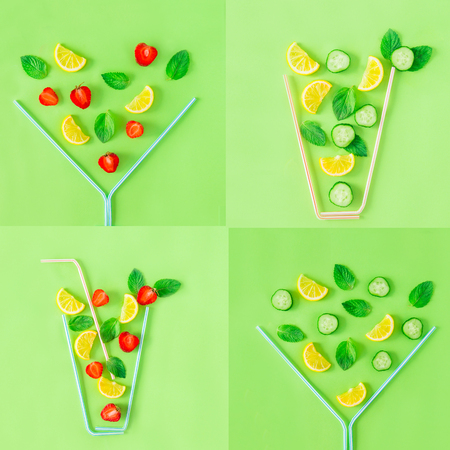 Creative pattern of strawberry and cucumber lemonade glasses made with coctail straws with falling ingredients on green background. Summer drinks. Minimal food concept. Square. Copy space