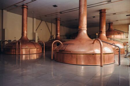 Brewing production - mash vats. Modern brewery factory interior. Steel tanks or vats for filtration beer. Industrial background.