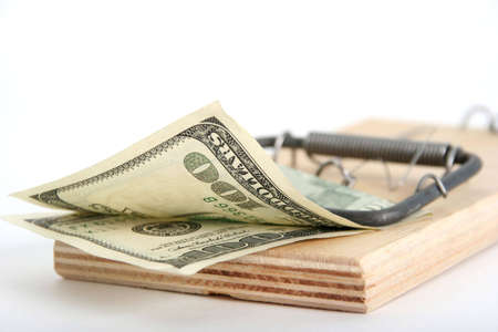 one hundred dollars: one hundred dollars banknote in the mousetrap Stock Photo