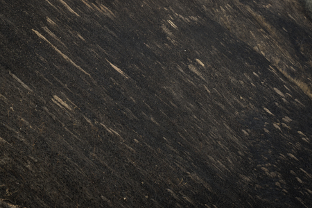 Scorched dry grass on a black slope