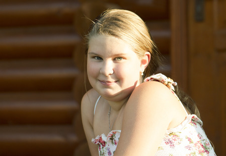 11 years: Thel girl of 11 years old is looking directly and joyfully smiles. Stock Photo