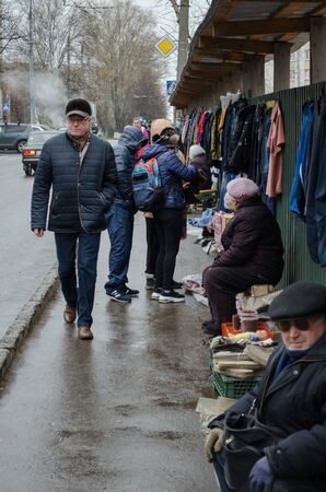 Vladimir, Russia November 10, 2018 Baturin street, spontaneous market of junkmen along the sidewalk Sajtókép