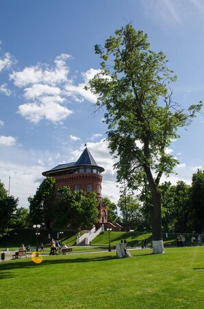 Water tower in the center of Vladimir on a sunny day with walking tourists
