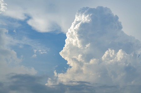 A large cumulus cloud illuminated on one side. Thunder Sky. Sun beams from the clouds Stock Photo