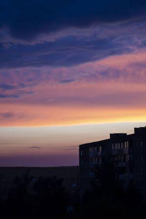 Sunset sky Purple and orange sky. Sunset building silhouette 版權商用圖片