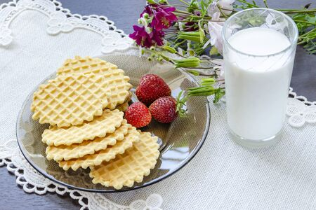 A bouquet of flowers for breakfast of waffles and milk